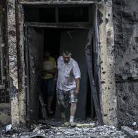 Ukraine army retakes town on edge of rebel bastion Donetsk