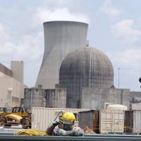 Men assemble a new reactor at the Vogtle nuclear plant in Waynesboro, Georgia, on June 13. | AP
