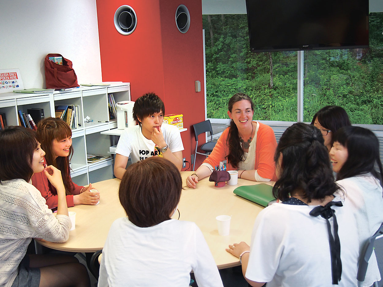 Students and a teacher chat at the English Salon.