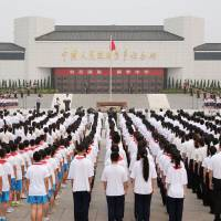 Students take part in a ceremony Monday in Beijing to commemorate the 77th anniversary of the Marco Polo Bridge incident, a skirmish between Chinese and Japanese troops on July 7, 1937, that is viewed as the official start of the Sino-Japanese War. | KYODO