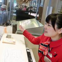 Chinese employee at Tokyo deptartment store says hospitality is key