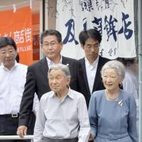Emperor Akihito and Empress Michiko visit a shopping center in the town of Minamisanriku, Miyagi Prefecture, on Wednesday. | KYODO
