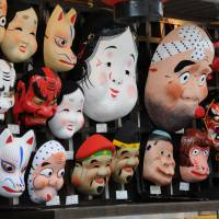 Colorful masks made of traditional Japanese paper are sold at a shop along Nakamise, a busy traditional arcade in the Asakusa district. | SATOKO KAWASAKI