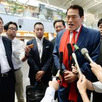 Antonio Inoki takes questions from reporters before departing from Beijing Capital International Airport for Pyongyang on Thursday. | KYODO