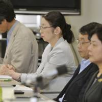 Atsuko Muraki (second from left), vice minister at the Health, Labor and Welfare Ministry, lobbied for recordings to be recommended in the interrogation of criminal suspects. She is pictured on Monday as a member of an advisory panel under the Justice Ministry's Legislative Council. | KYODO