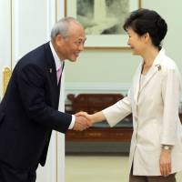 Tokyo Gov. Yoichi Masuzoe bows as he greets South Korean President Park Geun-hye before the two held talks in Seoul on Friday. | KYODO