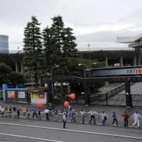 Protesters march against Olympic stadium replacement plan