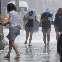 More than 500,000 people were urged to evacuate their homes as Typhoon Neoguri approached Okinawa on Tuesday. | KYODO
