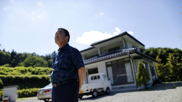 Fukushima farmer takes on Tepco over wife's suicide