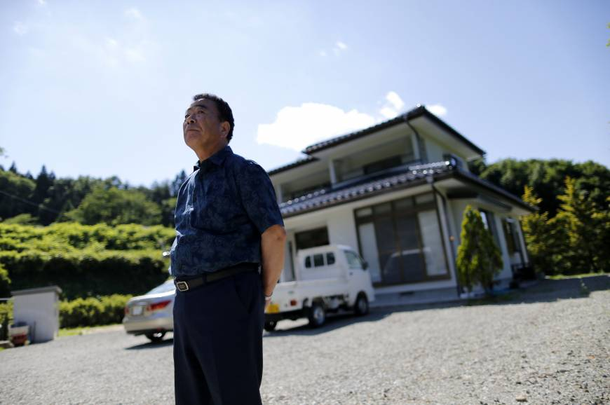 Mikio Watanabe's house in Kawamata, Fukushima Prefecture, remains in an exclusion zone and all he can do is maintain it during short visits. Being unemployed and forced to live elsewhere was too much for his wife, who burned herself to death during what she thought would be their final stay at the house.