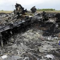 Ukraine, rebels argue over access to downed airliner site; Europeans give Putin 'last chance'