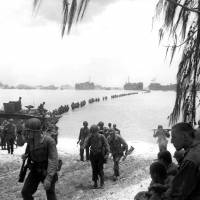 This July 1944 file photo shows U.S. Army reinforcement troops making an amphibious landing on the coral reef at Saipan. | AP