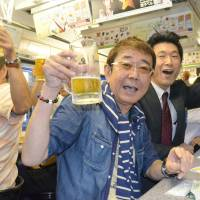 Riders chug on Nagasaki beer tram