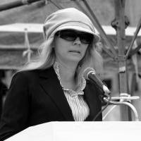 Coming out: Fisher speaks at a peace rally in Okinawa in 2008. The hat and dark glasses were her 'security blanket,' she says. | COURTESY OF CATHERINE FISHER