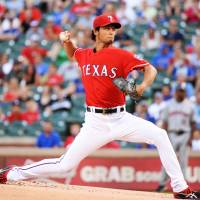 Pounded: Texas' Yu Darvish fires a pitch against Houston on Wednesday night. The Astros downed the Rangers 8-4. | KYODO
