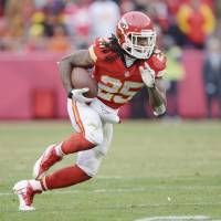Chiefs give star running back Charles two-year extension