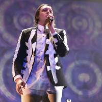 Main stage: Arcade Fire vocalist Win Butler performs on the Green Stage on Saturday. | CHIEKO KATO