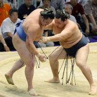 Hakuho alone at top