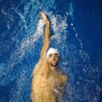 Rounding into form: Michael Phelps continued his comeback with a victory in the 100-meter backstroke on Saturday in Athens, Georgia. Phelps won in a time of 53.88 seconds. | AP