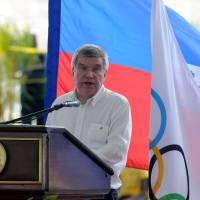 Visionary: IOC president Thomas Bach, seen here speaking in Port-au-Prince last week, has big plans for the governing body of the Olympic Games in the coming years. | AFP-JIJI