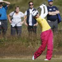 Out in front: Ayako Uehara tees off on the 13th hole in the first round of the Women's British Open in Southport, England, on Thursday. Uehara carded a 68 and leads by one stroke. | KYODO