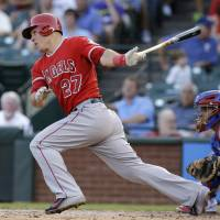 Productive outing: Los Angeles' Mike Trout strokes an RBI single against Texas in the second inning on Thursday night. | AP