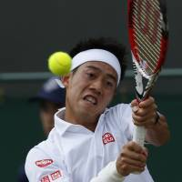 Road ends here: Kei Nishikori hits a return against Milos Raonic on Tuesday at Wimbledon. Raonic eliminated Nishikori. | AP