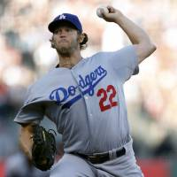 Gets 12th win: Los Angeles starter Clayton Kershaw fires a pitch against San Francisco in the third inning on Saturday night. | AP