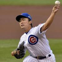 Strikes out six in victory: Chicago's Tsuyoshi Wada throws a pitch against Colorado in the first inning on Monday night. | KYODO