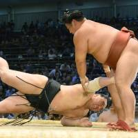 Man down: Yokozuna Harumafuji hits the ground during his bout against Yoshikaze at the Nagoya Grand Sumo Tournament on Wednesday. | KYODO