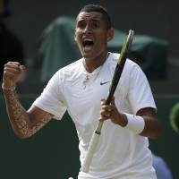 Just do it: Nick Kyrgios celebrates during his match against Rafael Nadal at Wimbledon on Tuesday. Kyrgios, ranked 144th in the world, beat No. 1 Nadal 7-6 (7-5), 5-7, 7-6 (7-5), 6-3. | REUTERS