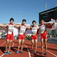 Teaming up: (From left) Japan's Yuki Koike, Yoshihide Kiryu, Takuya Kawakami and Masaharu Mori are seen after finishing second in the men's 4x100-meter relay final at the IAAF Junior World Championships on Saturday in Eugene, Oregon. | GETTY IMAGES/KYODO