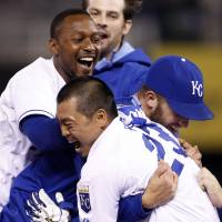 A-OK: The Royals' Norichika Aoki (right) is congratulated by teammates after hitting a walk-off single in the 14th inning of Kansas City's 2-1 win over the Indians on Thursday. | AP
