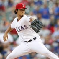 Double digit wins again: Texas starter Yu Darvish fires a pitch against New York on Monday night. | REUTERS/USA TODAY SPORTS