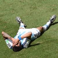 Sit this one out: Argentina midfielder Angel Di Maria will miss his team's World Cup semifinal match against the Netherlands after suffering a thigh injury during the quarterfinals. | AFP
