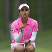 Out in front: Ai Miyazato lines up a putt during the LPGA International Crown on Thursday. | AFP-JIJI