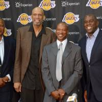 It's Showtime: New Lakers head coach Byron Scott (second from right) poses for a photo alongside former teammates (from left) Jamaal Wilkes, Kareem Abdul-Jabbar and Magic Johnson at a news conference on Tuesday in El Segundo, California. | REUTERS/USA TODAY SPORTS