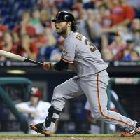 Crawford, Giants roll past Phillies in 14th
