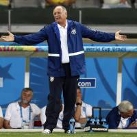 Marked man: Brazil coach Luiz Felipe Scolari must be replaced to move past the shock of the country's 7-1 loss to Germany in the World Cup semifinals, according to former Japan coach Zico. | AP