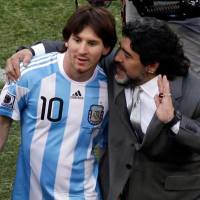 Blunt assessment: Diego Maradona, seen here with Lionel Messi in 2010, thinks Colombia's James Rodriguez should have been named the top player of the 2014 World Cup. | AP