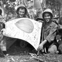 Trophy: U.S. troops hold a Japanese flag captured in July 1944 during the Battle of Saipan. | KYODO