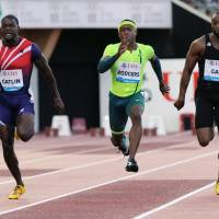 Sweep: American Justin Gatlin races against compatriots Tyson Gay and Michael Rodgers in the 100 meters at the Diamond League meet in Lausanne, Switzerland, on Thursday. | AFP-JIJI
