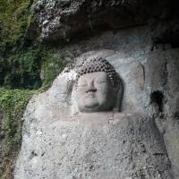 Time scarred: One of the great rock carvings at Kumano magaibutsu, said to be  from the eighth century. | STEPHEN MANSFIELD