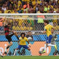 Germany's Thomas Mueller opens the scoring in the 11th minute.   AFP-JIJI