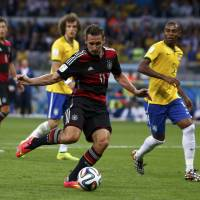 Domination: Germany's Miroslav Klose sets a new all-time record with his 16th World Cup goal. | REUTERS