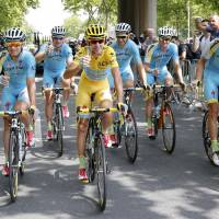 Toast of the town: Italian Vincenzo Nibali (center) and his Astana teammates hold glasses of champagne during the final stage of the Tour de France on Sunday. Nibali won the race. | REUTERS