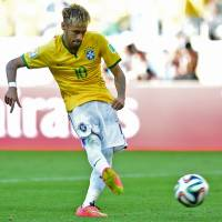 Good to go: Brazil star Neymar will be able to play in the quarterfinal with Colombia despite being injured in a second-round game against Chile on Saturday. | AFP-JIJI