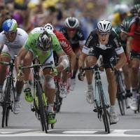 Almost too close to call: Italy's Matteo Trentin (right) beats Peter Sagan (left) to the finish line on Friday in Nancy, France. | AP