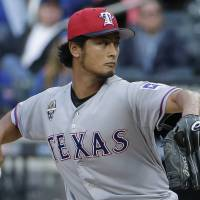 Not this time: Texas starting pitcher Yu Darvish delivers during the Rangers' 6-5 loss to the Mets on Friday. | AP