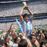 One last mountain to climb: Lionel Messi hopes to lead Argentina to a win over Germany in the World Cup final, just as Argentine legend Diego Maradona (above) did in 1986. | AP